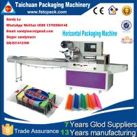 China Horizontal packaging machine for sponge , scourer, foam, baorbent cloth on sale