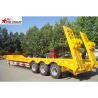 China 60T Semi Low Bed Trailer , Hide Tire 3 Axle Low Bed Trailer With Strong Trailer Frame wholesale