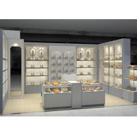 China Shopping Mall Retail Shoe Store Fixtures With Tall Cabinet And Tables Modern Style wholesale