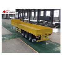 China 3 Axles Drop Side Front Load Trailer High Duty Steel Structure 60T Payload wholesale