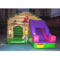 China Commercial backyard jungle theme kids inflatable jumping castle with slide made of best pvc tarpaulin wholesale