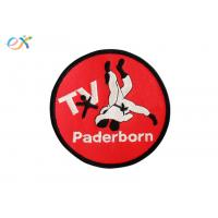 China Red Bottom Iron On Embroidered Sports Patches Polyester Material Round Shape wholesale