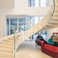 China European-Style Stainless Steel Glass Curved Staircase Arc Stairs wholesale