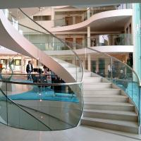 China Wood Step Glass Rails Curved Staircase with Stainless Steel Stringer and Glass Railing wholesale