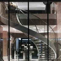China Indoor / Outdoor Stainless Steel Double Beam Curved Wood Stairs with Glass Railing wholesale