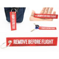 China Custom Embroidery Logo Remove Before Flight Keychain, Woven Logo Keychain, Red Remove Before Flight Keychain with Ring wholesale