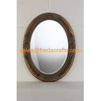 China Antique gold finish PU framed oval shaped wall mirror with carved flowers and bevelled mirror wholesale