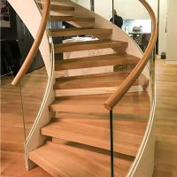 China New Style Curved Staircase Solid Wood Treads and Tempered Glass Railings wholesale